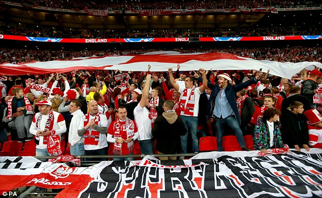 Home away from home: Poland fans pass a huge banner over their heads