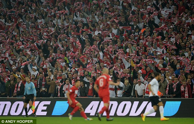 Looking on: Poland fans sing loudly as their team try to stop England qualifying for next year's World Cup
