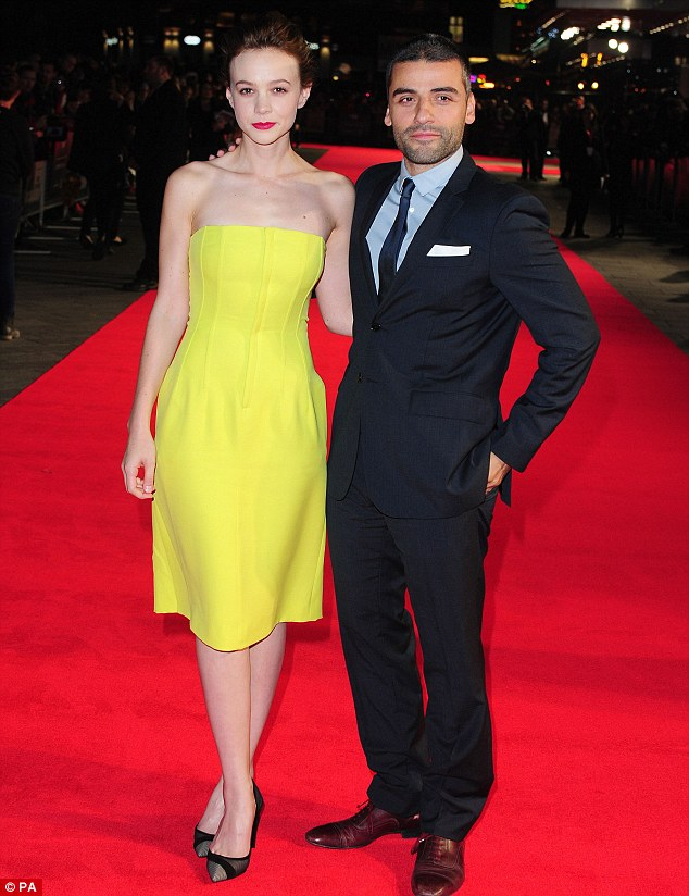 Posing up: Carey stood alongside co-star Oscar Isaac, who takes on the lead role of Llewyn Davis in the movie