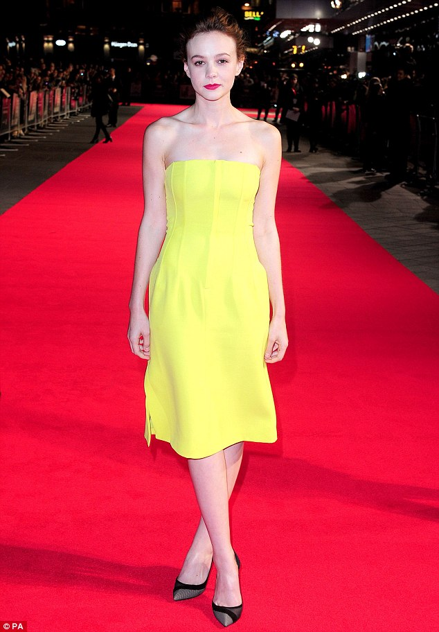 Not so mellow yellow! Carey Mulligan stood out in an eye-wateringly bright yellow dress on the red carpet for the premiere of her new movie Inside Llewyn Davis in London on Tuesday night