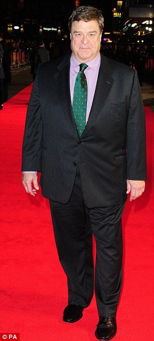 Suited and booted: Oscar and co-star John Goodman looked smart in their suits for the occasion