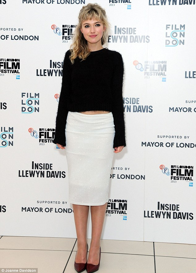 Monochrome chic: Imogen Poots looked stunning in her black jumper and white pencil skirt