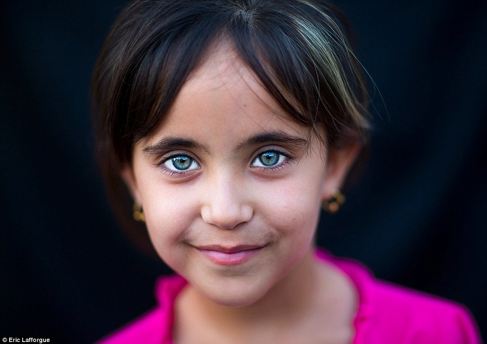 Pretty: This little girl is now safe in Kurdistan but it wasn't always the case - Iraqi Kurds became victims of Saddam Hussein's chemical weapons in 1988