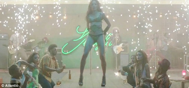 Sultry siren: Freida Pinto strips down to her lingerie in Bruno Mars' new music video for his single Gorilla
