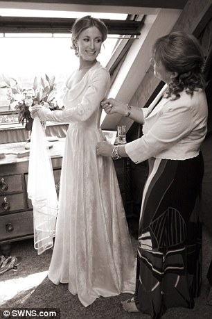 Getting ready: Lucy is zipped into the vintage dress