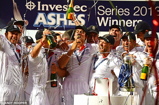 Well urn-ed: Cook kisses a replica Ashes trophy as celebrations for the 2013 series kick off