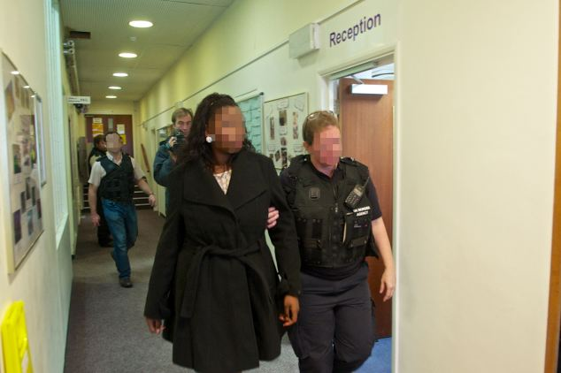Portuguese woman, 22, led away from ceremony after questioning. She is on bail until November 7