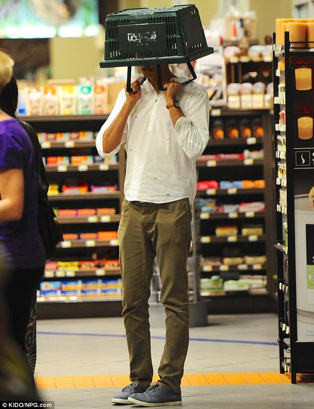 Trying to hide or goofing around? At one point, the actor covered his head with a shopping basket