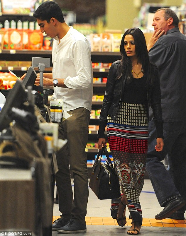Let me handle this! Dev was seen paying for their groceries, including a case of Kombucha and bottled water