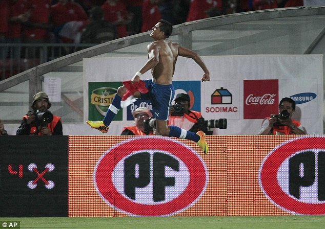 Jumping for joy: Barcelona's Alexis Sanchez scored for Chile in their 2-1 win over Ecuador