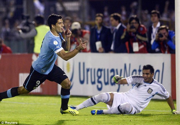 Celebration: Luis Suarez scored for Uruguay in their 3-2 win over Argentina in Montevideo