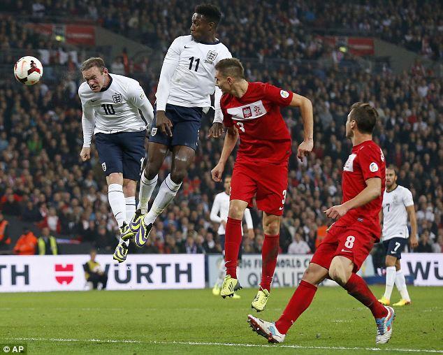 Head master: England's Wayne Rooney, left, scores the opening goal