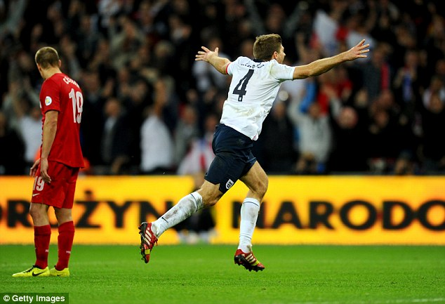 Brazil bound: Steven Gerrard celebrates as he ensures England will take part in World Cup 2014