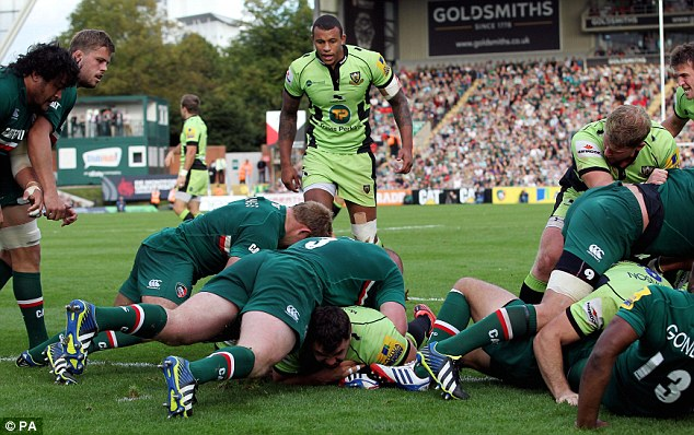 Out: Alex Corbisiero (centre, scoring a try) is injured and will miss the autumn series
