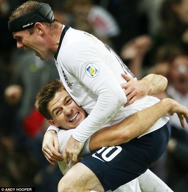 Jumping for joy: Goalscorers Wayne Rooney and Steven Gerrard celebrate
