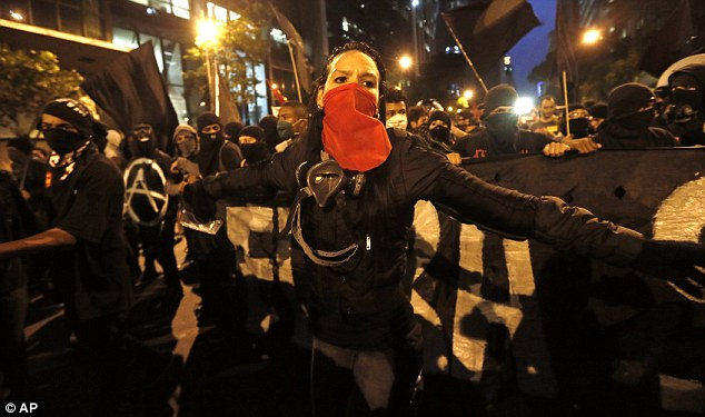 On the march: Thousands of demonstrators protest