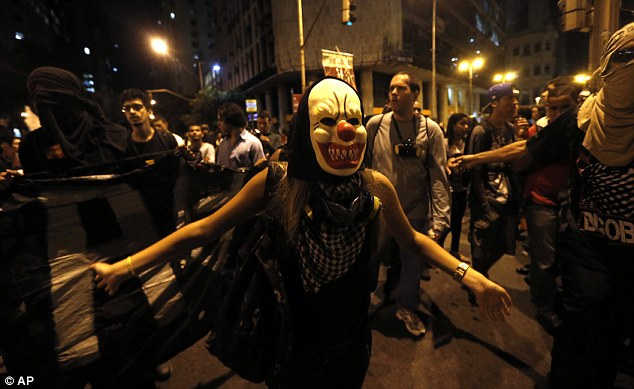 No masking these problems: A masked member of the Black Bloc anarchist group joins the protest