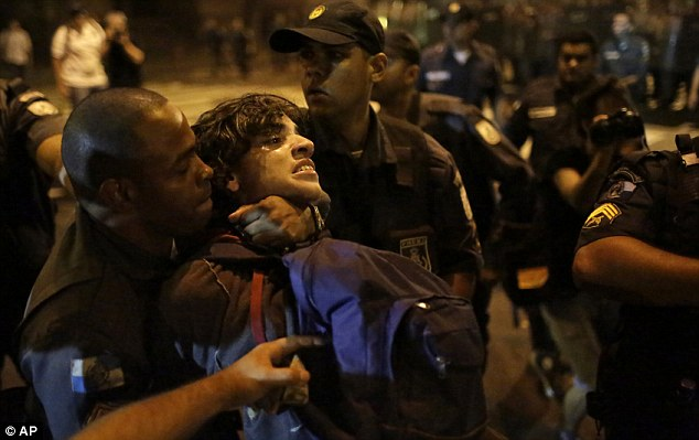 Long arm of the law: A police officer detains a protestor