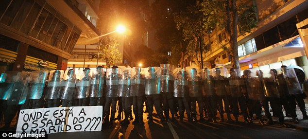 The Shield: Police stand watch before clashes between officer, teachers and anarchists group at a protest in Rio