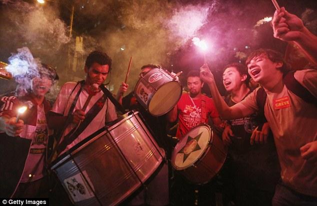 Banging the drum: Protestors in Rio