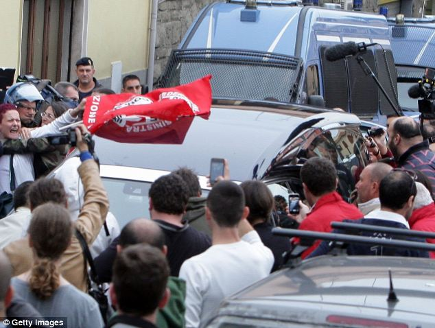 nger: People protest as the car with the body of Erich Priebke arrives at the church of Lefebvriani