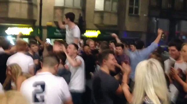 Chanting: A huge group of Newcastle students stopped traffic as they sang about Yaya Toure in the street