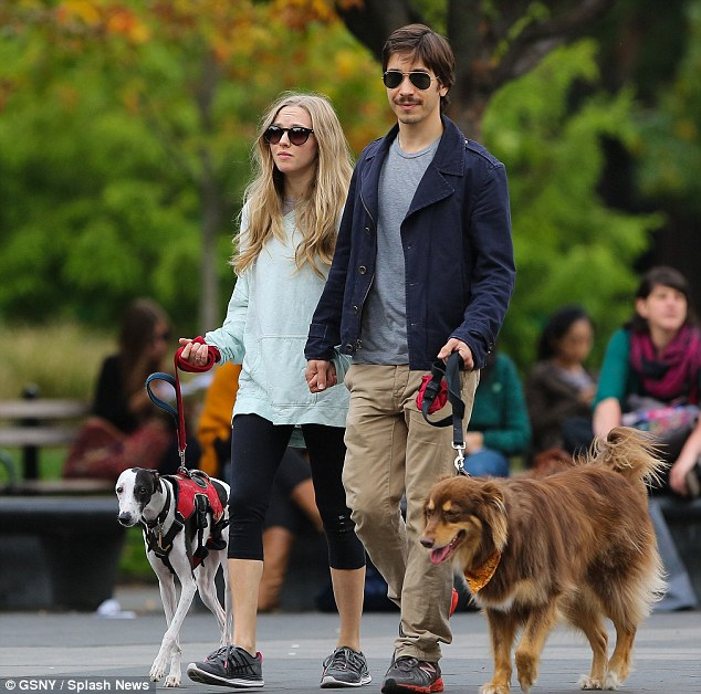More than puppy love: Amanda Seyfried and Justin Long look more in love than ever as they take their pooches for a walk in LA