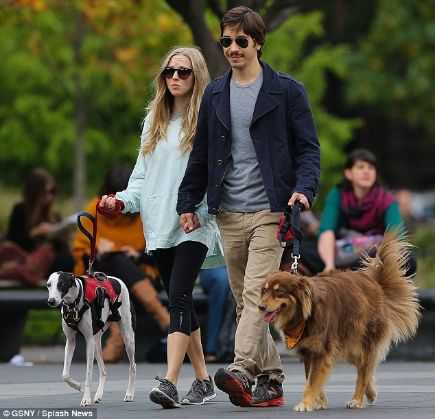 Walkies: Justin held on to Amanda's dog Finn, while the Mamma Mia star helped walk a greyhound