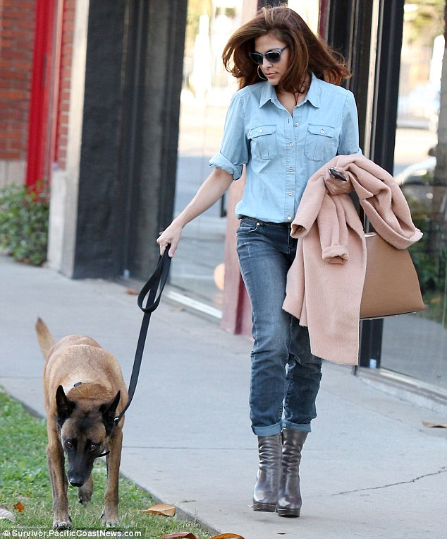Meanwhile: Eva Mendes was another Hollywood star showing her love for her pooch... as she stepped out with her dog Hugo