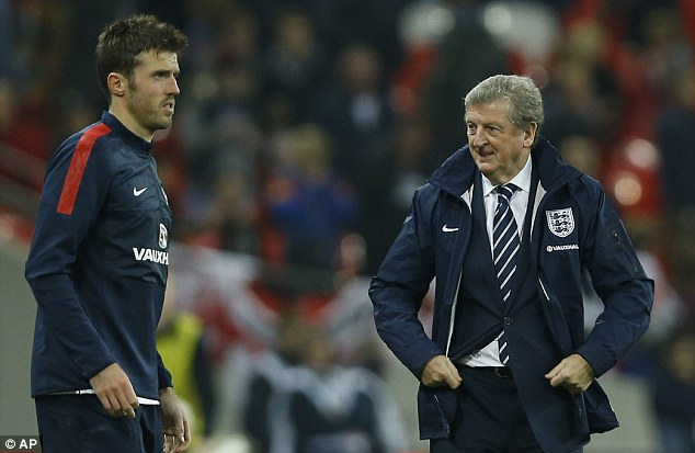 No wonder you're smiling, Roy: Hodgson's decision to play pass master Michael Carrick paid off