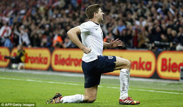 Kneesy does it: England captain Gerrard enjoys his moment after scoring the second goal against Poland