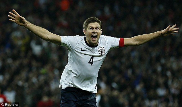 And they're off: Captain Steven Gerrard sealed the win over Poland and England's spot at the World Cup