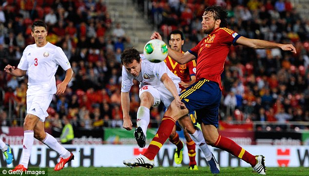 Shining among stars: Michu made his debut for Spain last week alongside some world greats
