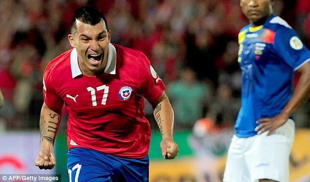 Hot streak: Cardiff midfielder Gary Medel celebrates scoring for Chile against Ecuador