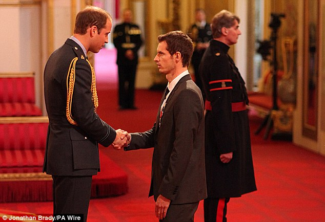 First time: Murray receives his OBE from Prince William who was first investiture ceremony