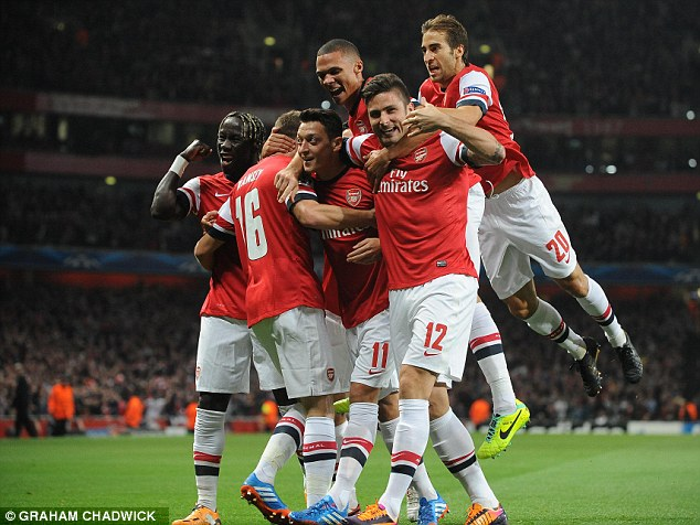 Reason to celebrate: Arsenal are top of the Premier League after an impressive to start to the season
