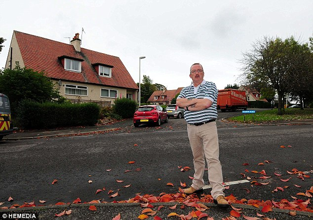 Anger: Glen Morrison, 49, wants to sell the council his home in Aberdeen - but they only want to buy his garden