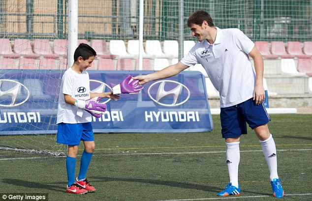 Not happy: Iker Casillas, pictured on Thursday at a Hyundai Masterclass session with children, says he will leave Real Madrid if he doesn't get his way