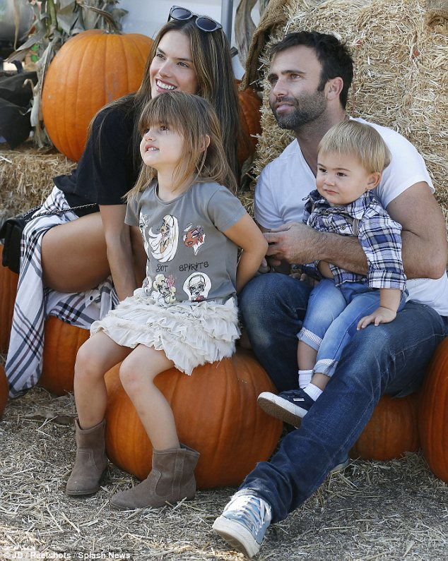 Happy family: Not seen Wednesday was Ambrosio's longtime fiancé Jamie Mazur and their five-year-old daughter Anja