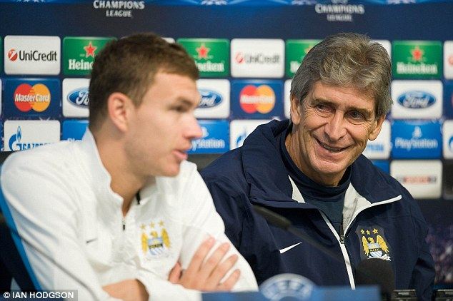 All smiles: New City boss Manuel Pellegrini is well known for his man-management skills