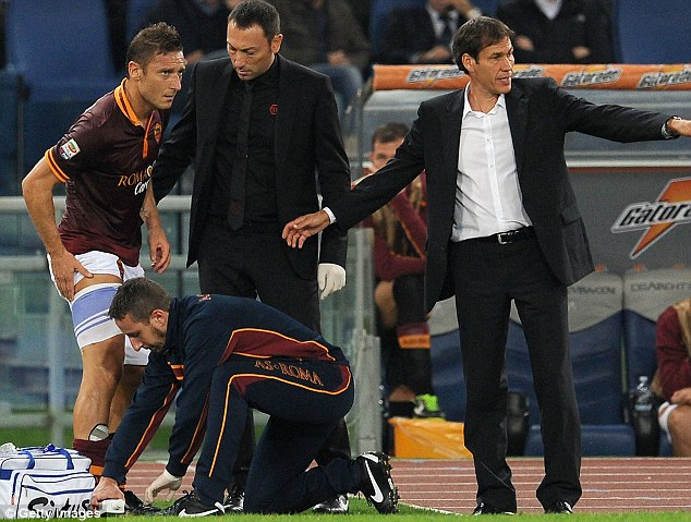 Concern: Francesco Totti was forced off during the first half because of injury