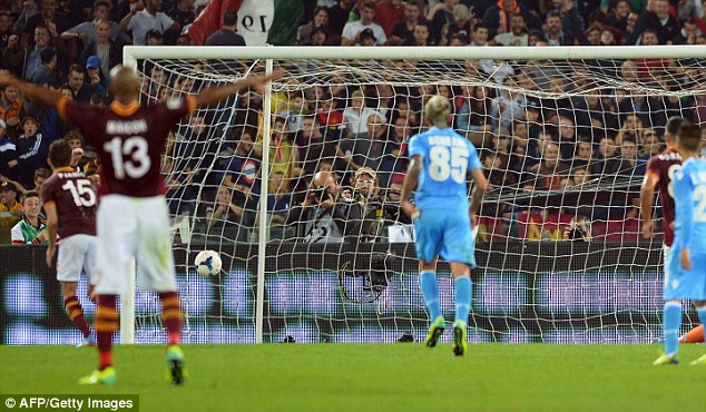 Spot on: Pjanic duly tucked home his penalty