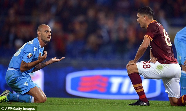Who, me? Napoli defender Paolo Cannavaro was sent off in the second half after conceding the penalty which led to Roma's second goal