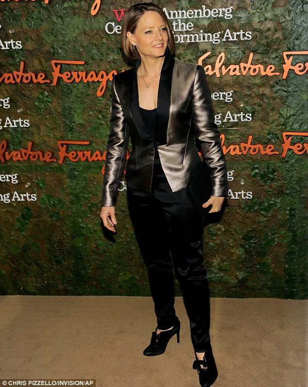 Shiny lady: Jodie Foster wore a chrome coloured suit jacket over black trousers for the gala