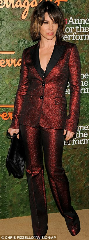 An edgy touch: Karolina Kurkova wore a metal and black mini dress with double splits and zip detail while Evangeline Lilly wore a striking red metallic suit