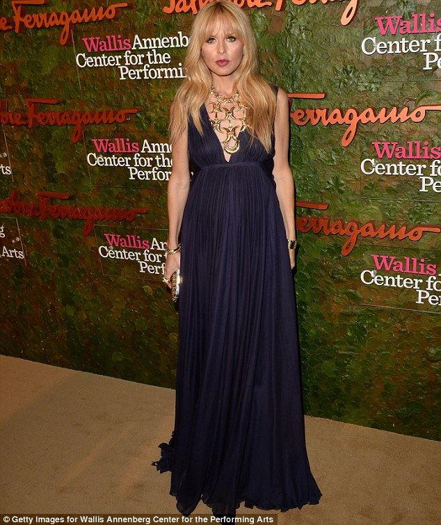 Embellished: Rachel Zoe sported an ornate gold necklace over her plunging blue frock