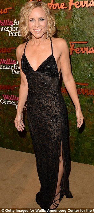 Contrasting styles: Camilla Belle sported a frilly pink gown, while Mario Bello wore a black patterned frock with split