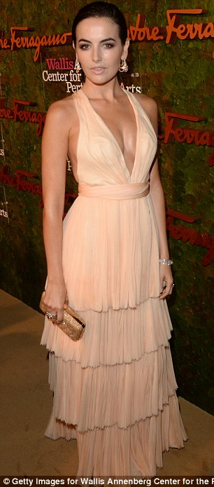 Contrasting styles: Camilla Belle sported a frilly pink gown, while Mario Bello stuck to black