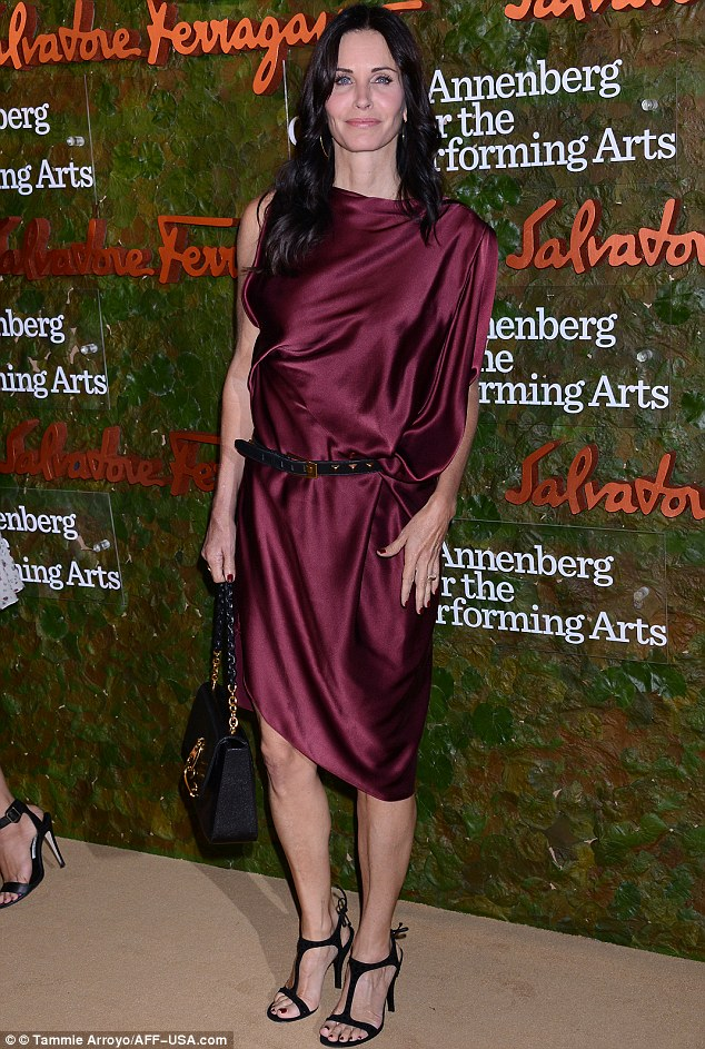 Silky: Courteney Cox sported a rather baggy looking maroon gown with black belt