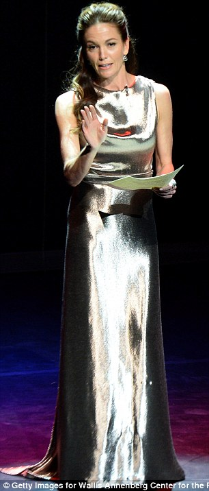 Silver screen siren: Diane Lane wore a striking metallic gown while giving a performance on stage